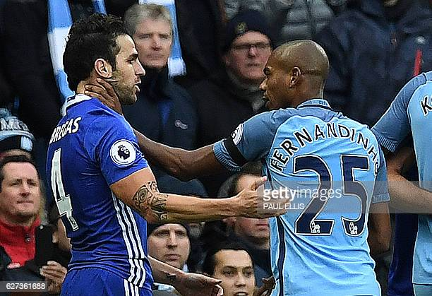 Manchester City's Brazilian midfielder Fernandinho fights with Chelsea's Spanish midfielder Cesc Fabregas following Manchester City's Argentinian...