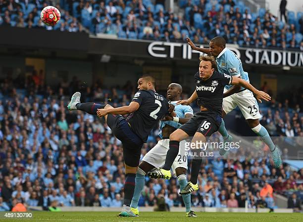 Manchester City's Brazilian midfielder Fernandinho heads unsuccessfully towards goal during the English Premier League football match between...