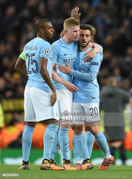 Manchester City's Brazilian midfielder Fernandinho Manchester City's Belgian midfielder Kevin De Bruyne and Manchester City's Portuguese midfielder...