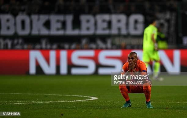 Manchester City's Brazilian midfielder Fernandinho reacts after he received the red card during the UEFA group C Champions League football match...