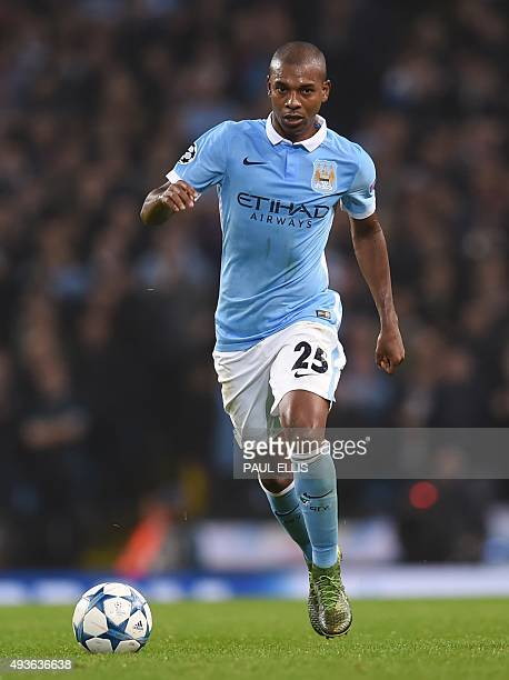 Manchester City's Brazilian midfielder Fernandinho runs during a UEFA Champions league Group D football match between Manchester City and Sevilla at...