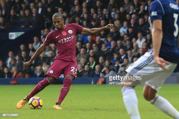 Manchester City's Brazilian midfielder Fernandinho scores the team's second goal during the English Premier League football match between West...