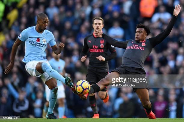 Manchester City's Brazilian midfielder Fernandinho vies with Arsenal's Nigerian striker Alex Iwobi during the English Premier League football match...