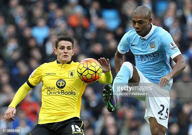 Manchester City's Brazilian midfielder Fernandinho vies with Aston Villa's English midfielder Ashley Westwood during the English Premier League...