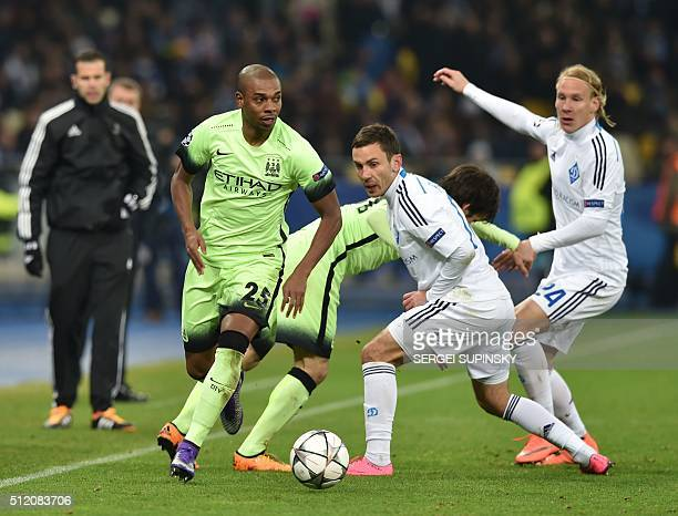 Manchester City's Brazilian midfielder Fernandinho vies with Dynamo Kiev's Ukrainian midfielder Serhiy Rybalka and Dynamo Kiev's Croatian defender...