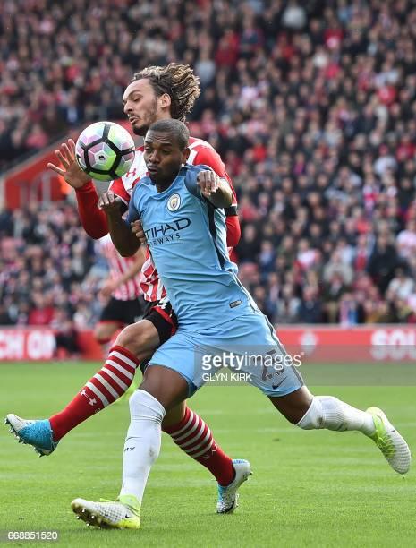 Manchester City's Brazilian midfielder Fernandinho vies with Southampton's Italian striker Manolo Gabbiadini during the English Premier League...