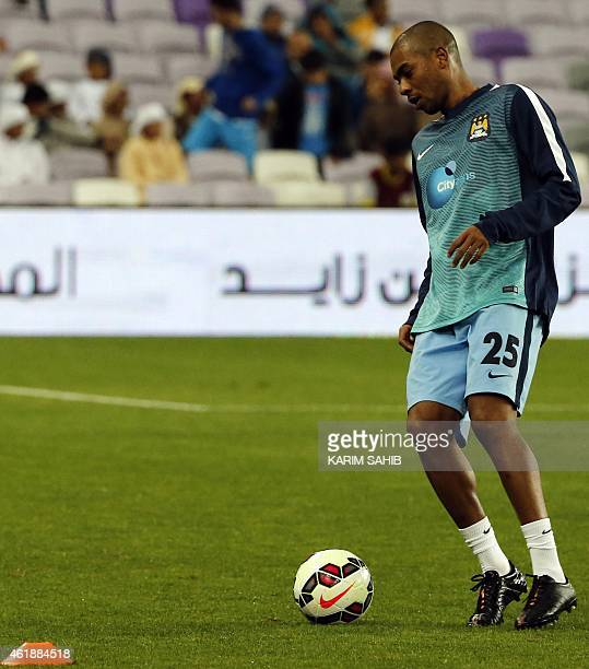 Manchester City's Brazilian midfielder Fernandinho warms up before his friendly football match against Hamburg at the Hazza Bin Zayed stadium in...