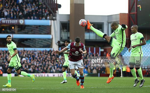 Manchester City's Brazilian midfielder Fernando clears the ball during the English FA Cup fourth round football match between Aston Villa and...