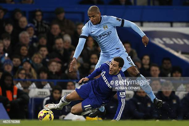 Manchester City's Brazilian midfielder Fernando fouls Chelsea's Belgian midfielder Eden Hazard during the English Premier League football match...