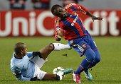 Manchester City's Brazilian midfielder Fernando fouls CSKA Moscow's Ivorian forward Seydou Doumbia during the UEFA Champions League group E football...