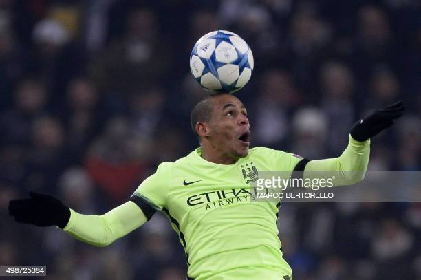 Manchester City's Brazilian midfielder Fernando heads the ball during the UEFA Champions League football match Juventus vs Manchester City on...