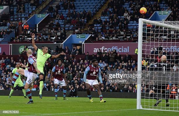 Manchester City's Brazilian midfielder Fernando heads the ball toward goal by Aston Villa's US goalkeeper Brad Guzan during the English Premier...