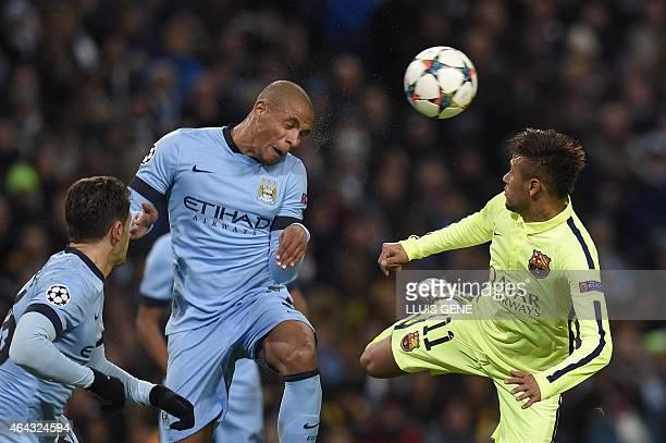 Manchester City's Brazilian midfielder Fernando heads the ball under pressure from Barcelona's Brazilian forward Neymar da Silva Santos Junior during...