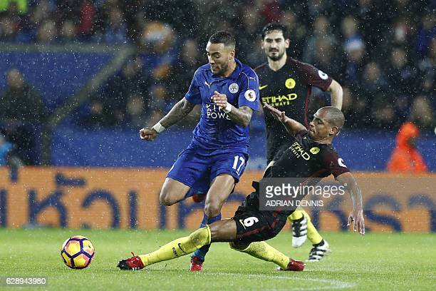 Manchester City's Brazilian midfielder Fernando tackles Leicester City's English defender Danny Simpson during the English Premier League football...