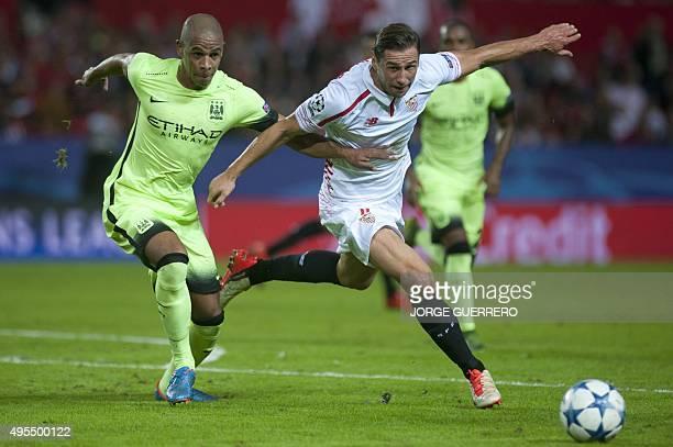 Manchester City's Brazilian midfielder Fernando vies with Sevilla's Polish midfielder Grzegorz Krychowiak during the UEFA Champions League football...