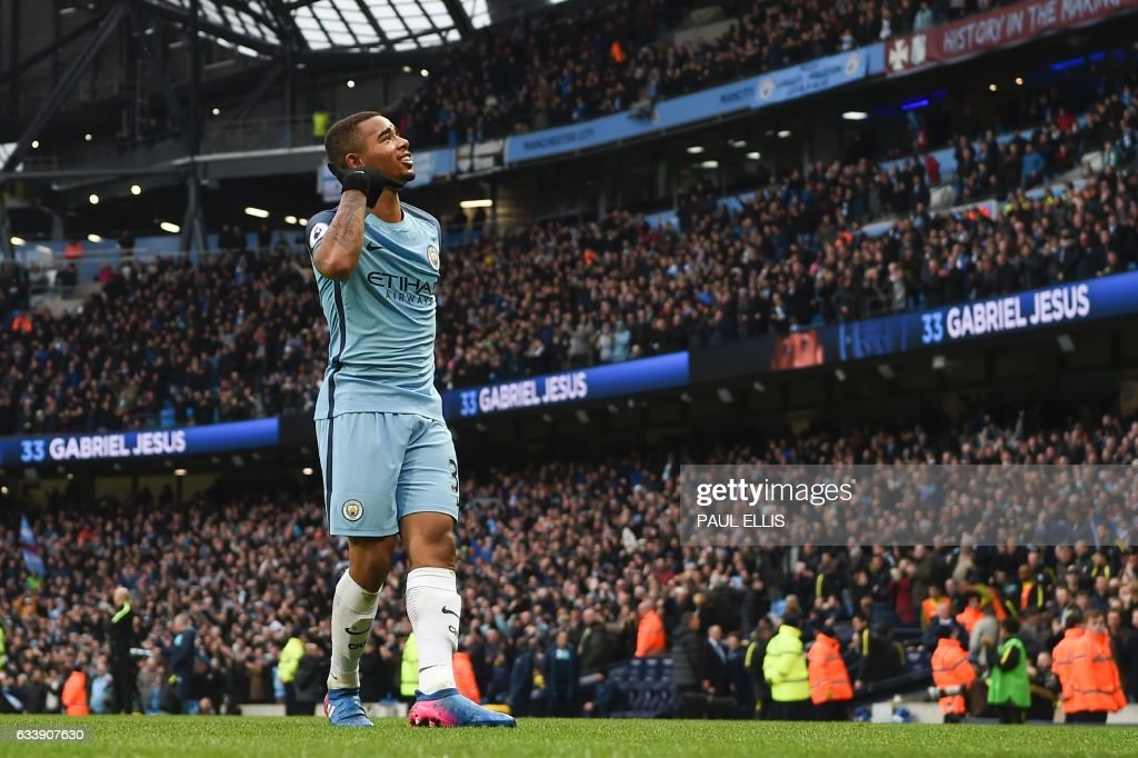 Manchester City's Brazilian striker Gabriel Jesus celebrates after scoring their late winning goal during the English Premier League football match between Manchester City and Swansea City at the Etihad Stadium in Manchester, north west England, on February 5, 2017. Manchester City won the game 2-1. / AFP / PAUL ELLIS / RESTRICTED TO EDITORIAL USE. No use with unauthorized audio, video, data, fixture lists, club/league logos or 'live' services. Online in-match use limited to 75 images, no video emulation. No use in betting, games or single club/league/player publications. /