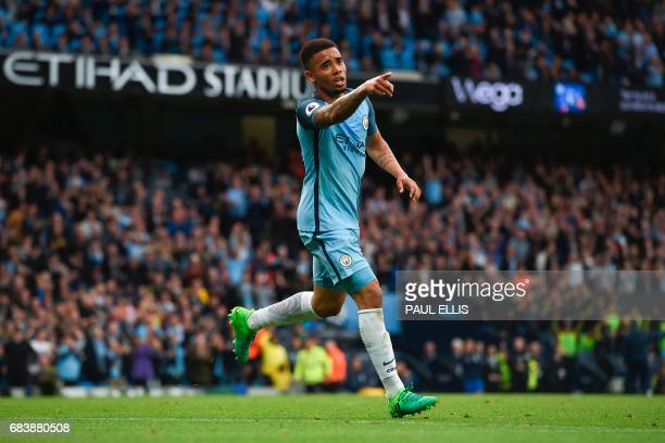 Manchester City's Brazilian striker Gabriel Jesus celebrates scoring the opening goal during the English Premier League football match between...