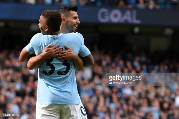 Manchester City's Brazilian striker Gabriel Jesus celebrates with Manchester City's Argentinian striker Sergio Aguero after scoring their third goal...