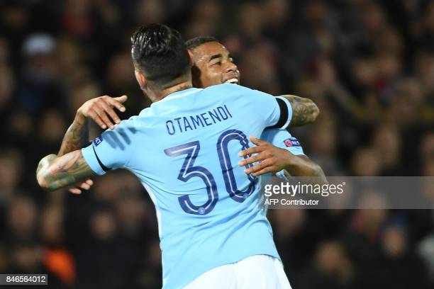 Manchester City's Brazilian striker Gabriel Jesus celebrates with Manchester City's Argentinian defender Nicolas Otamendi after scoring a goal during...