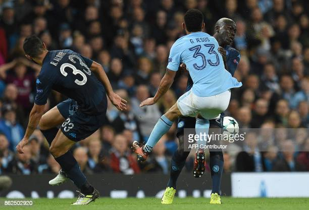 Manchester City's Brazilian striker Gabriel Jesus clashes with Napoli's Frenchborn Senegalise defender Kalidou Koulibaly during the UEFA Champions...