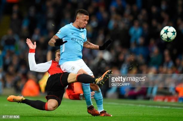 TOPSHOT Manchester City's Brazilian striker Gabriel Jesus is tackled by Feyenoord's Dutch defender Bart Nieuwkoop during the UEFA Champions League...