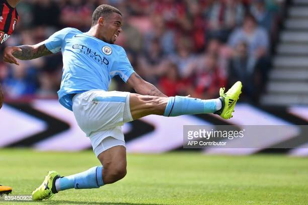 Manchester City's Brazilian striker Gabriel Jesus shoots to score their first goal during the English Premier League football match between...