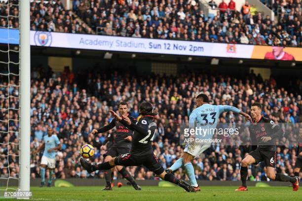 Manchester City's Brazilian striker Gabriel Jesus shoots to score their third goal during the English Premier League football match between...