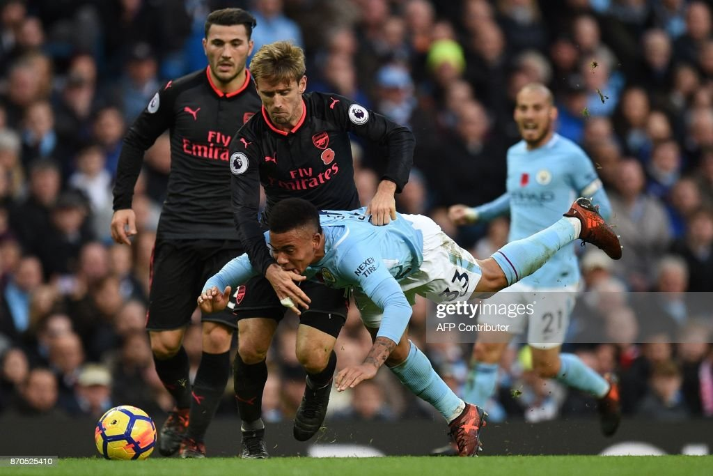 Manchester City's Brazilian striker Gabriel Jesus vies with Arsenal's Spanish defender Nacho Monreal during the English Premier League football match between Manchester City and Arsenal at the Etihad Stadium in Manchester, north west England, on November 5, 2017. / AFP PHOTO / Oli SCARFF / RESTRICTED TO EDITORIAL USE. No use with unauthorized audio, video, data, fixture lists, club/league logos or 'live' services. Online in-match use limited to 75 images, no video emulation. No use in betting, games or single club/league/player publications. /