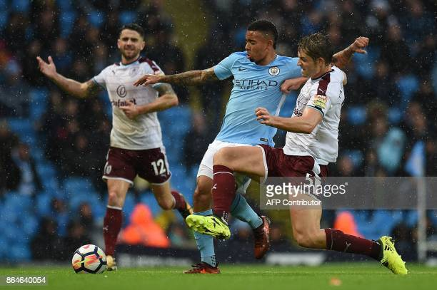 Manchester City's Brazilian striker Gabriel Jesus vies with Burnley's Irish midfielder Robbie Brady and Burnley's English defender James Tarkowski...
