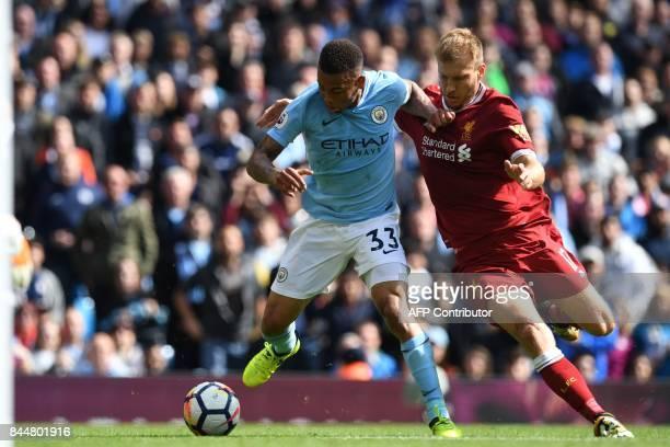 Manchester City's Brazilian striker Gabriel Jesus vies with Liverpool's Estonian defender Ragnar Klavan during the English Premier League football...