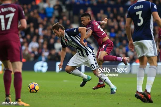 Manchester City's Brazilian striker Gabriel Jesus vies with West Bromwich Albion's Polish midfielder Grzegorz Krychowiak during the English Premier...