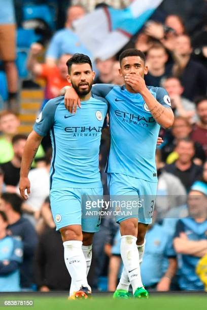Manchester City's Brazilian striker Gabriel Jesus walks with Manchester City's Argentinian striker Sergio Aguero as he celebrates scoring the opening...