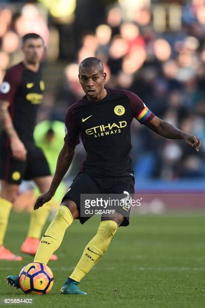 Manchester City's captain Fernandinho wearing a rainbow armband passes the ball during the English Premier League football match between Burnley and...