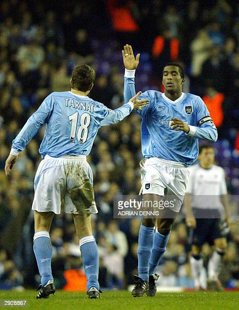 Manchester City's captain Sylvain Distin celebrates scoring a goal with Michael Tarnat against Tottenham Hotspur during the FA Cup 4th Round Replay...