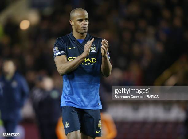Manchester City's captain Vincent Kompany applauds the City fans at the end of game
