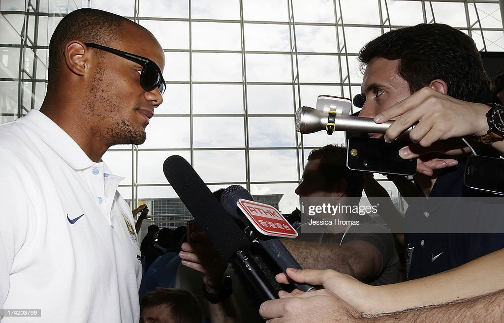 Manchester City's Captain <a gi-track='captionPersonalityLinkClicked' href=/galleries/search?phrase=Vincent+Kompany&family=editorial&specificpeople=504694 ng-click='$event.stopPropagation()'>Vincent Kompany</a> speaks to the media at Hong Kong Airport after the team arrives to compete in the Barcleys Asia Trophy on July 22, 2013 in Hong Kong, Hong Kong.