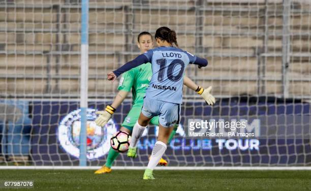 Manchester City's Carli Lloyd has a shot straight at Birmingham City's AnnKatrin Berger during the FA Women's Super League match at the Academy...