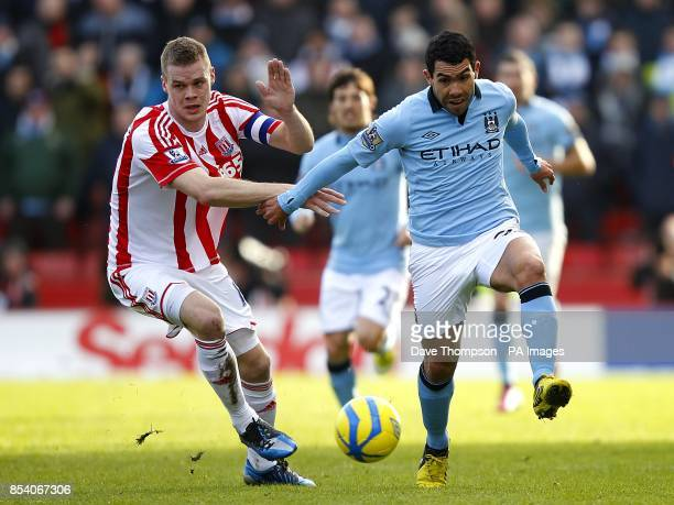 Manchester City's Carlos Tevez skips past Stoke City's Ryan Shawcross