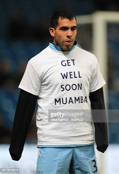 Manchester City's Carlos Tevez wearing a tshirt reading 'Get Well Soon Muamba' during the warm up