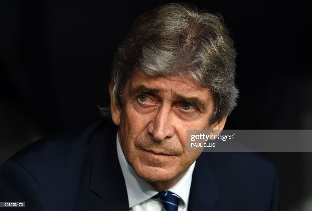Manchester City's Chilean coach Manuel Pellegrini looks on before the UEFA Champions League semi-final second leg football match Real Madrid CF vs Manchester City FC at the Santiago Bernabeu stadium in Madrid, on May 4, 2016. / AFP / PAUL