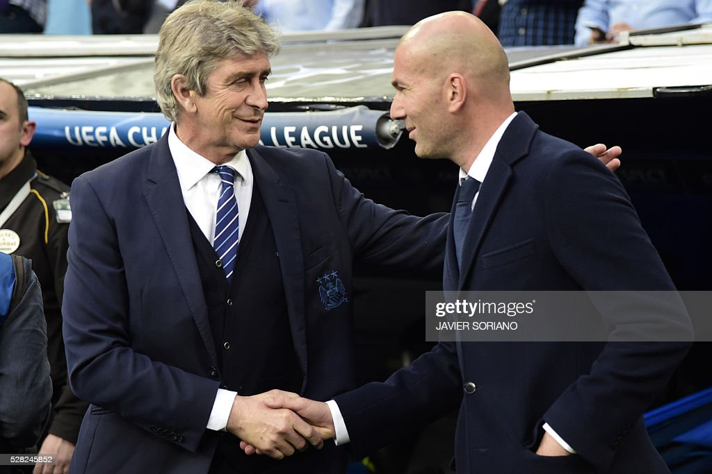 Manchester City's Chilean coach Manuel Pellegrini (L) shakes hands with Real Madrid's French coach Zinedine Zidane during the UEFA Champions League semi-final second leg football match Real Madrid CF vs Manchester City FC at the Santiago Bernabeu stadium in Madrid on May 4, 2016. / AFP / JAVIER