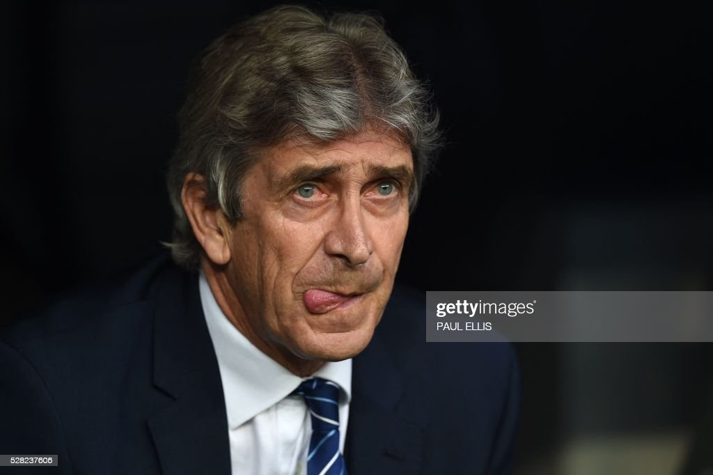 Manchester City's Chilean coach Manuel Pellegrini sticks out his tongue before the UEFA Champions League semi-final second leg football match Real Madrid CF vs Manchester City FC at the Santiago Bernabeu stadium in Madrid, on May 4, 2016. / AFP / PAUL