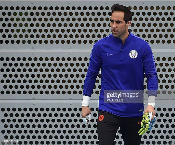 Manchester City's Chilean goalkeeper Claudio Bravo arrives for a training session at the City Academy training complex in Manchester north west...