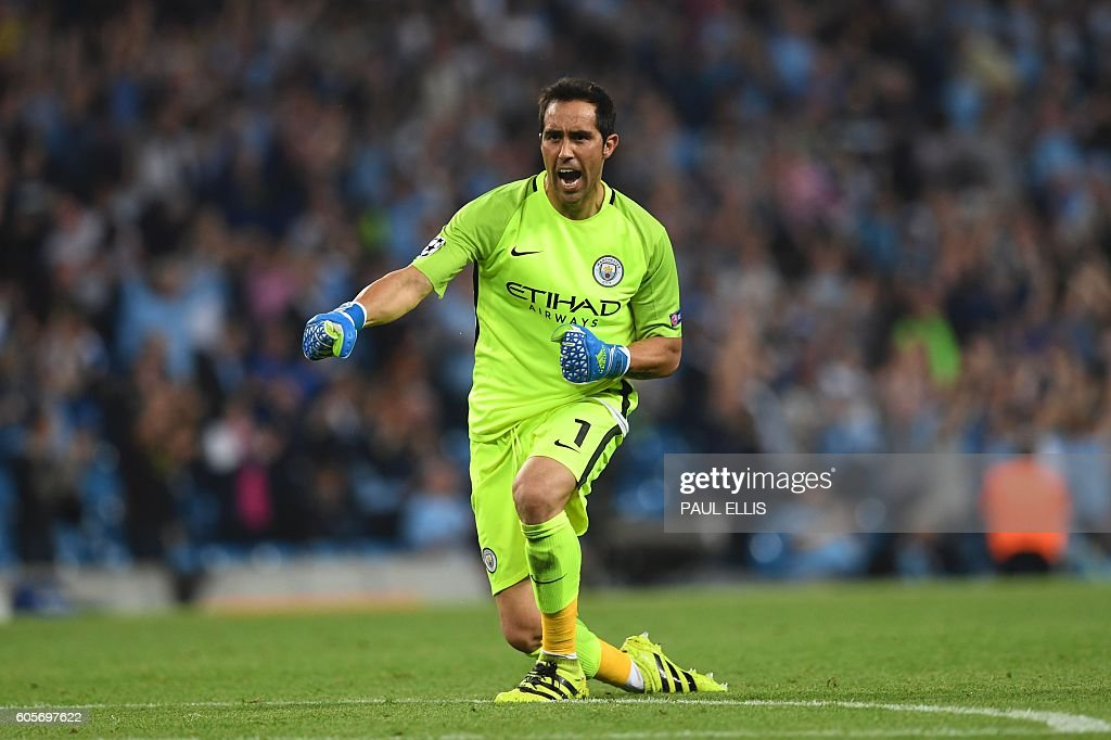 Manchester City's Chilean goalkeeper Claudio Bravo celebrates their fourth goal during the UEFA Champions League group C football match between Manchester City and Borussia Monchengladbach at the Etihad stadium in Manchester, northwest England, on September 14, 2016. / AFP / PAUL