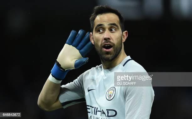 Manchester City's Chilean goalkeeper Claudio Bravo gestures to the Huddersfield fans after Manchester City's Nigerian striker Kelechi Iheanacho...