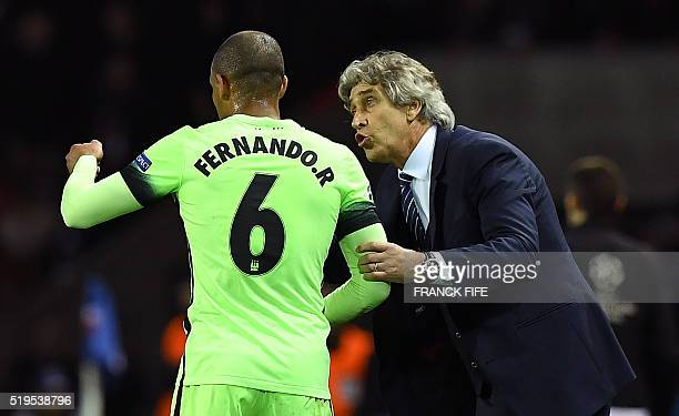 Manchester City's Chilean manager Manuel Pellegrini gives instructions to Manchester City's Brazilian midfielder Fernando during the UEFA Champions...