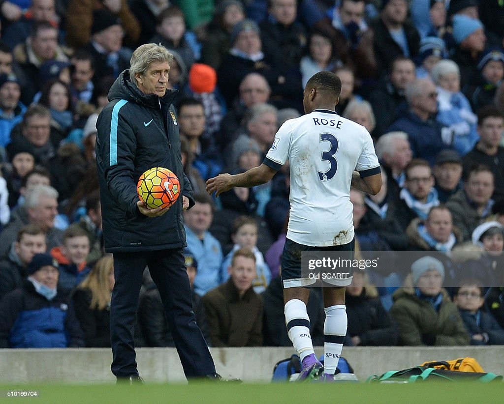 Manchester City's Chilean manager Manuel Pellegrini (L) hands the ball to Tottenham Hotspur's English defender Danny Rose after it went out of play during the English Premier League football match between Manchester City and Tottenham Hotspur at the Etihad Stadium in Manchester, north west England, on February 14, 2016. / AFP / OLI SCARFF / RESTRICTED TO EDITORIAL USE. No use with unauthorized audio, video, data, fixture lists, club/league logos or 'live' services. Online in-match use limited to 75 images, no video emulation. No use in betting, games or single club/league/player publications. /