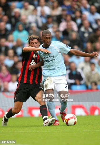 Manchester City's Daniel Sturridge and AC Milan's Paolo Maldini battle for the ball