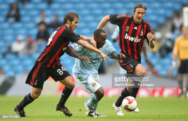 Manchester City's Darius Vassell battles with AC Milan's Mathieu Flamini and Massimo Ambrosini during the friendly match at the City of Manchester...