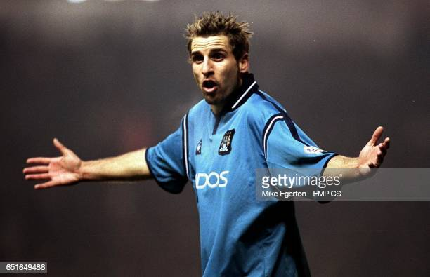 Manchester City's Darren Huckerby shrugs his shoulders